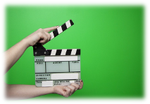 Film take starting in front of green screen