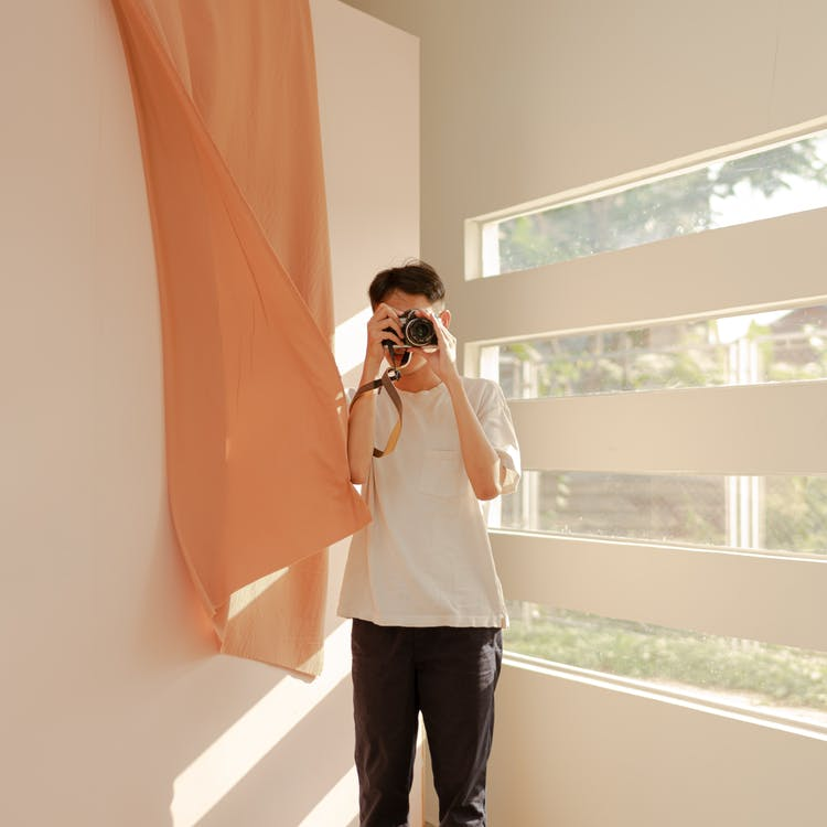 A man photographing a home's interior